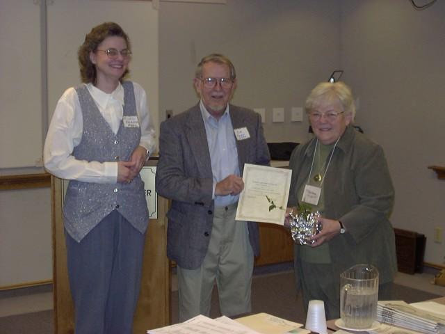 Jean Keenan accepting award on behalf of Barbara Sieg and the Howard County Master Gardeners