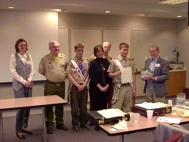 Recipient Ben Will with parents and fellow Scouts and Scout leaders.