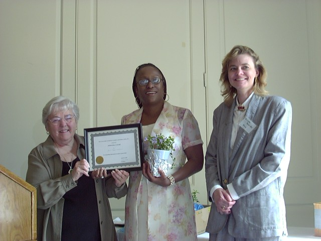 Janice Hayes-Williams accepting award from Jean Keenan and Kristin Kraske
