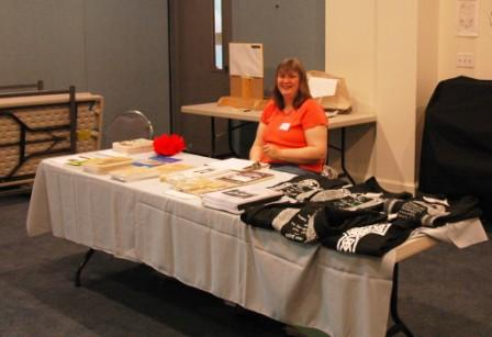 Frances Becker manning the sales table